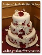 red fondant roses on a three tiered cake