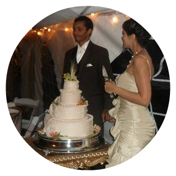 happy bride and groom with wedding cake