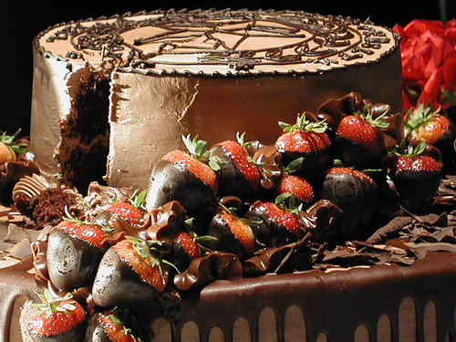 cake with chocolate covered strawberries