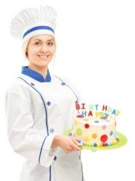 three cake decorators decorating a cake