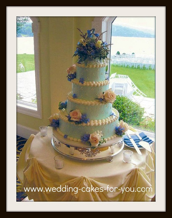 Blue buttercream wedding cake with fresh flowers