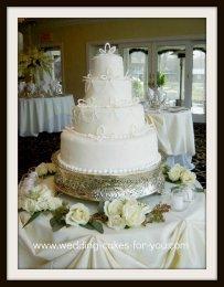 A Fondant wedding cake with royal icing stringwork