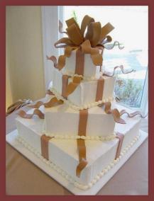 square wedding cake with fondant ribbon