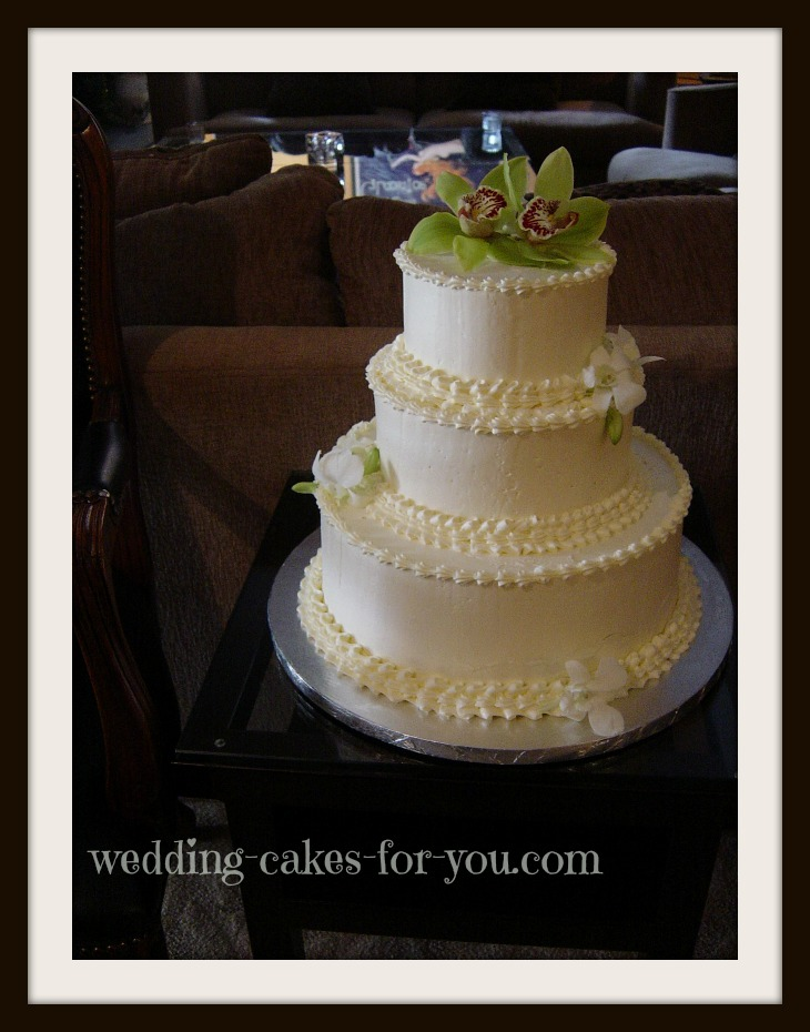 Simple wedding cake with green orchids
