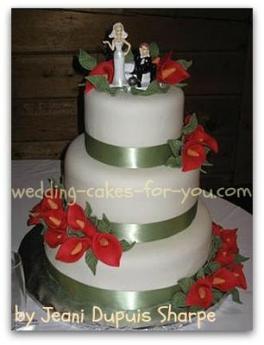 pink fondant flowers on a fondant wedding cake