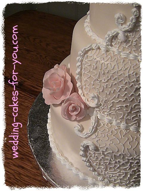 pink wedding cake with cornelli lace