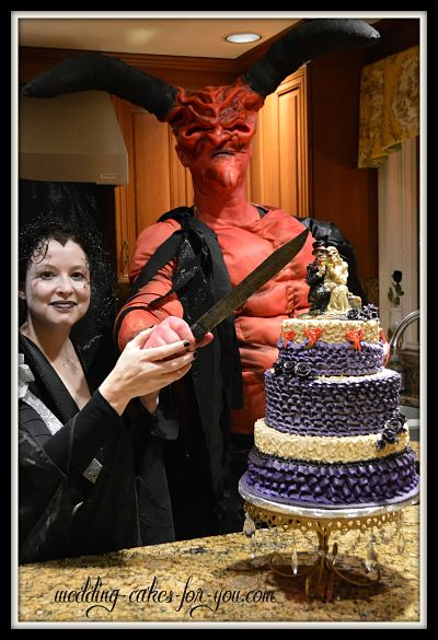 Lily and Lord of Darkness Posing With Halloween Wedding Cake