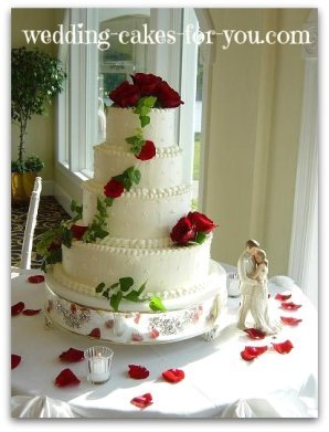 A dotted Swiss wedding cake design with fresh flowers
