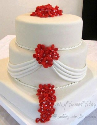 fondant wedding cake with drapes by Sweet Stop