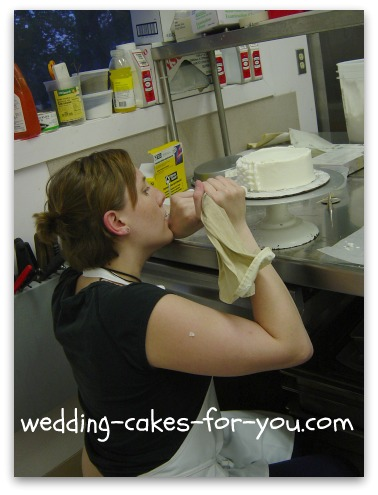 One of my students learning how to decorate a cake