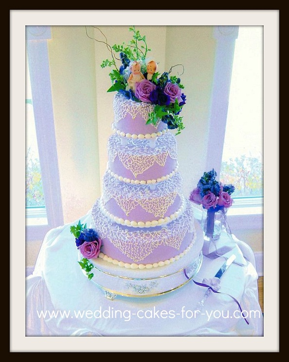 Lavender cake with vintage cupie doll cake topper
