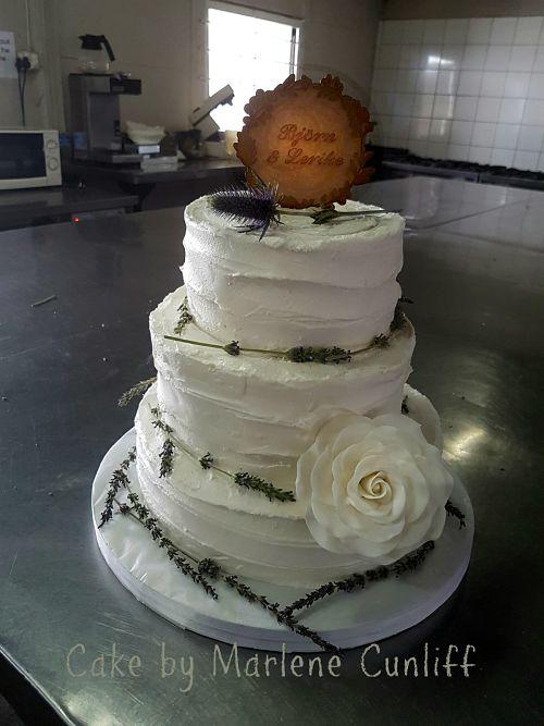 rustic wedding cake with fresh lavendar