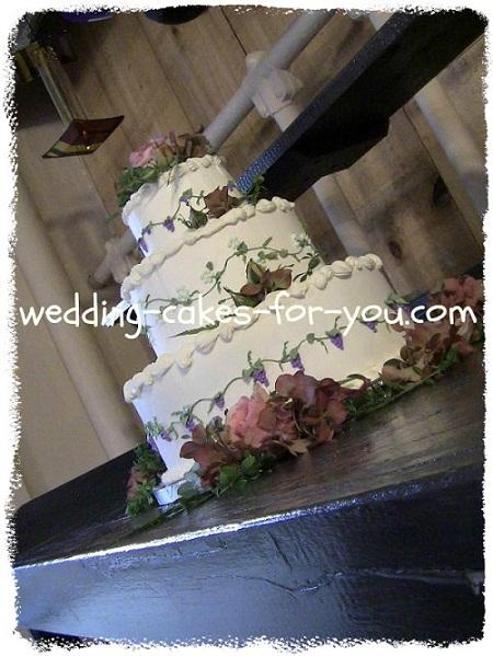 buttercream wedding cake with a grape design