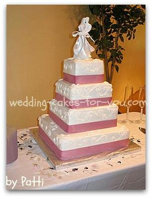 square wedding cake with pink ribbon