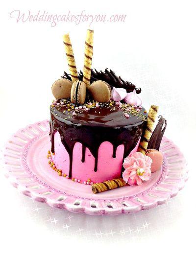 Chocolate drip cake over pink buttercream