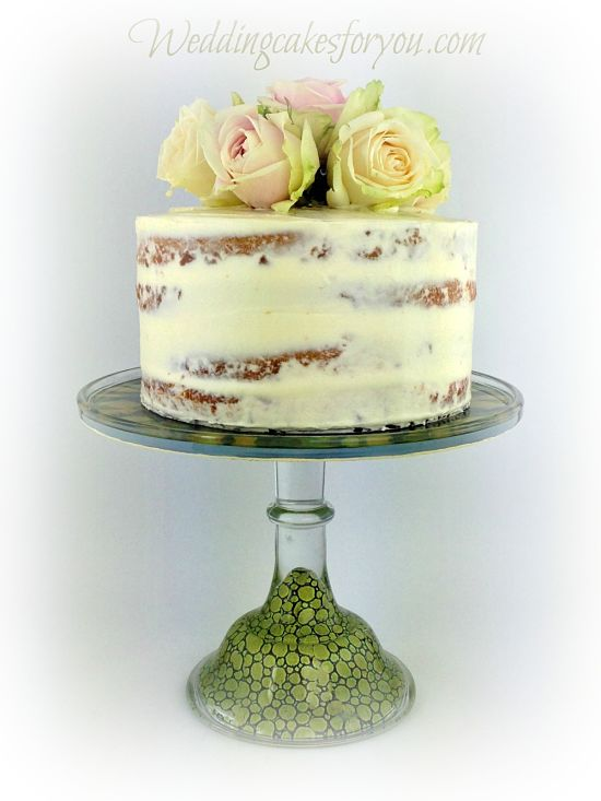 semi naked cake on a green cake stand