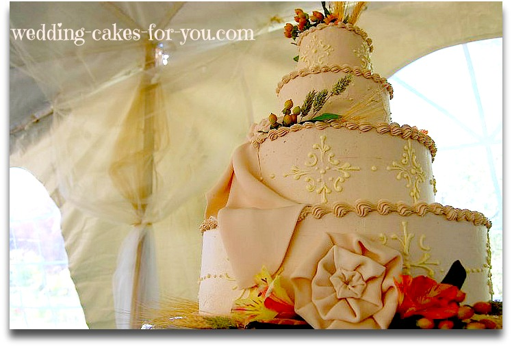 buttercream wedding cake with fondant drapes and flowers