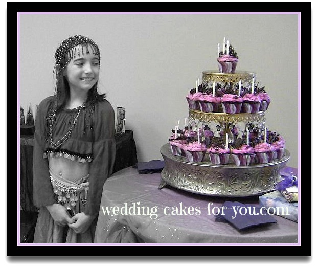 pink cupcakes on a silver cake stand