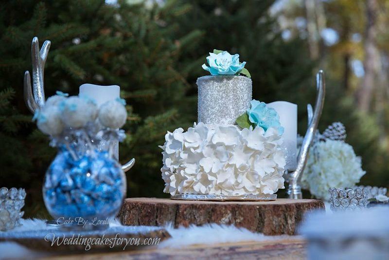 fondant wedding cake with blue gumpaste fantasy flowers