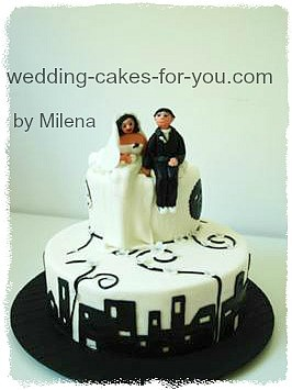 small wedding cake with cityscape