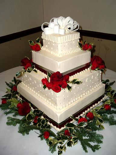 square wedding cake with red roses