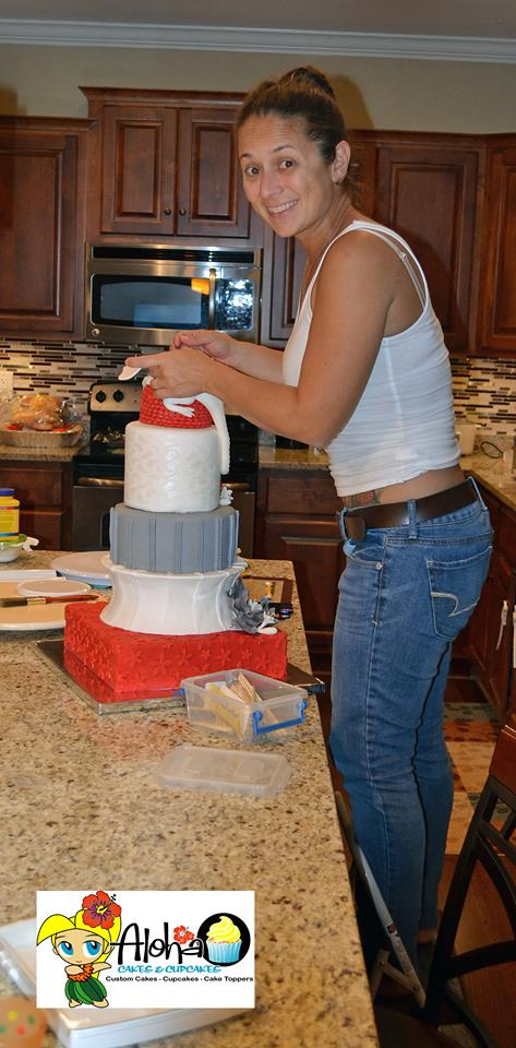 Sarah busy at work making a tiered cake