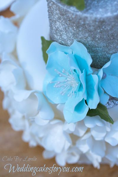 winter wedding cake with blue fantasy flowers