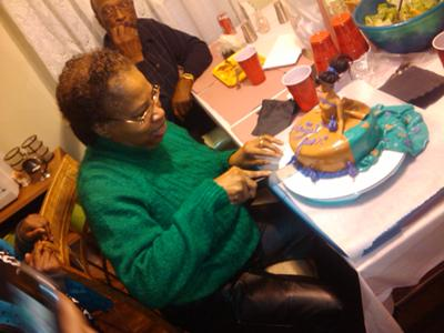 This is a photo of my aunt cutting her cake.