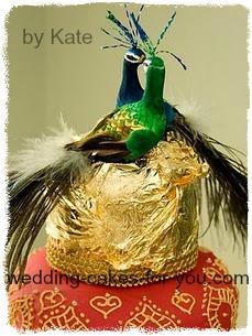 peacock cake topper on a mehndi inspired wedding cake
