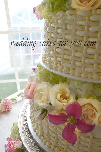 A close up of a beautiful basketweaved cake