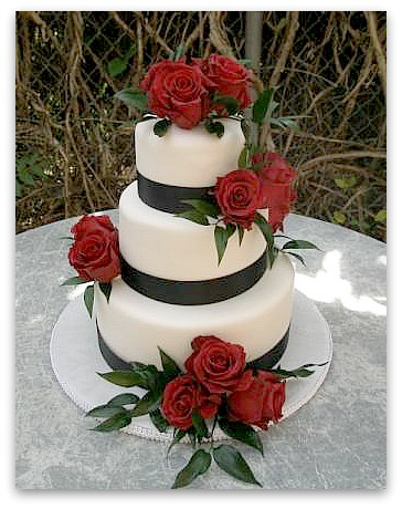 The cake base is a silver plateau black and white wedding cakes