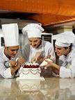 cake decorators decorating a cake