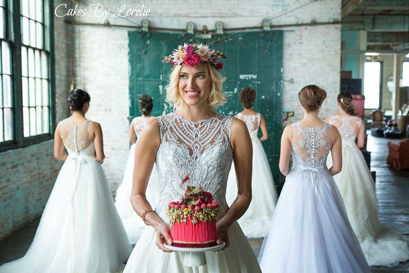 Kristen Taekman holding a mini wedding cake