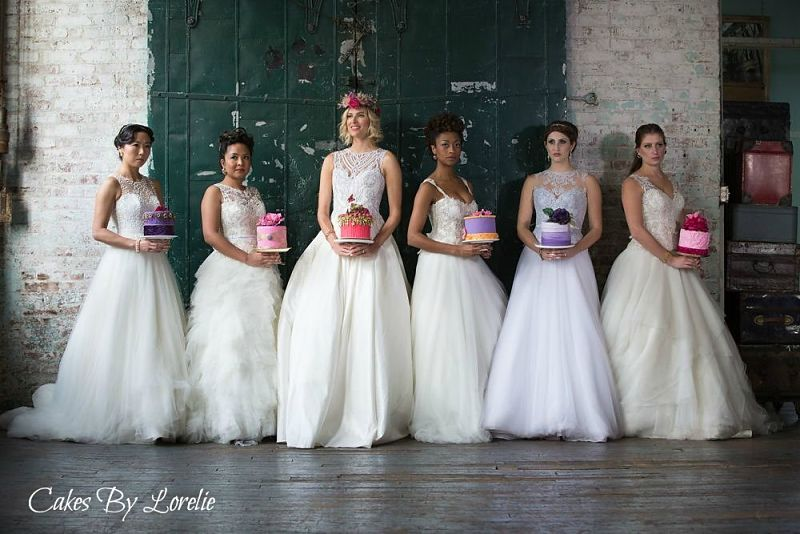 six beautiful brides holding six little cakes