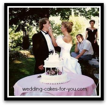 bride feeding the groom wedding cake