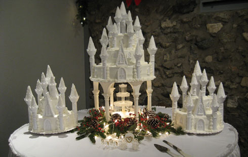 white castle wedding cake with fountain