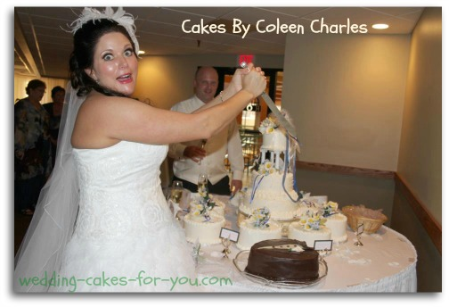 Bride cutting groom's cake