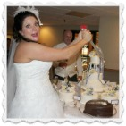 bride cutting grooms cake