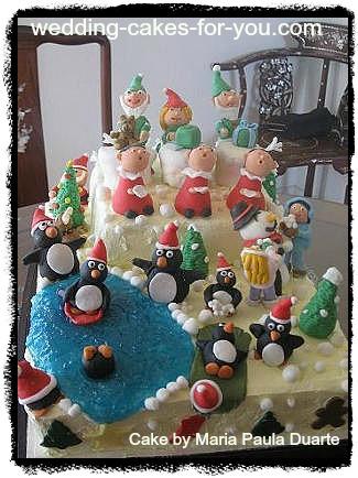Whimsical Christmas cake with fondant figurines