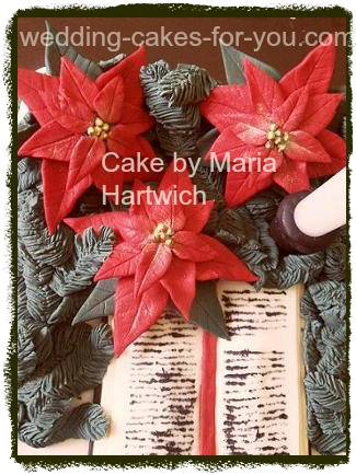 Christmas cake with fondant pointsettas