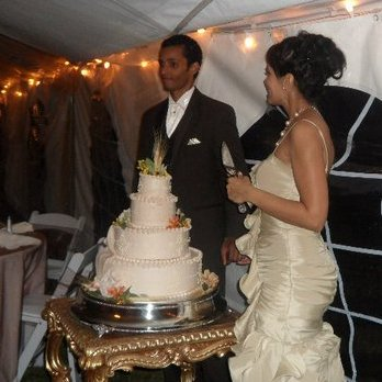 bride and groom with wedding cake