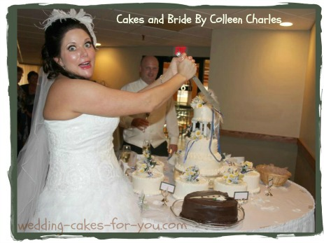 fun bride cutting the grooms cake