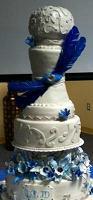 unique wedding cake with blue decorations