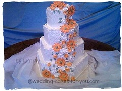 Orange daisies on a wedding cake