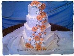 Orange daisies on a wedding cake