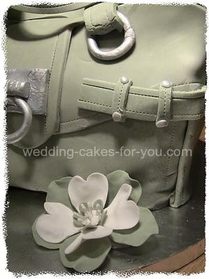My less than perfect fondant purse cake.