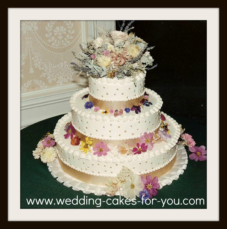 A buttercream cake with dried flowers