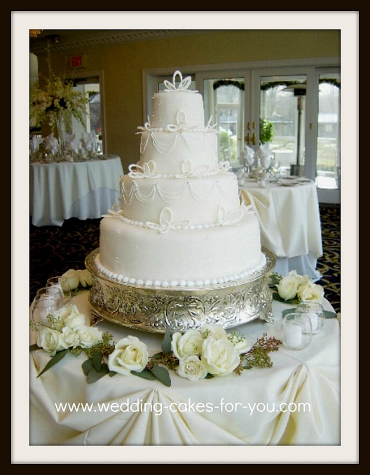 A Fondant wedding cake with royal icing stringwork