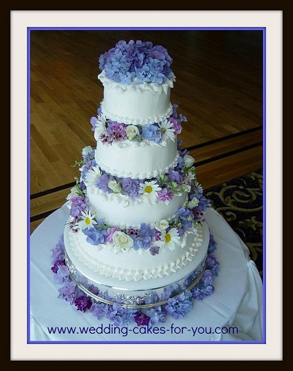 Four tiered cake with fresh flowers