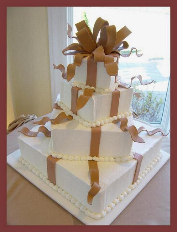 square wedding cake with fondant ribbon